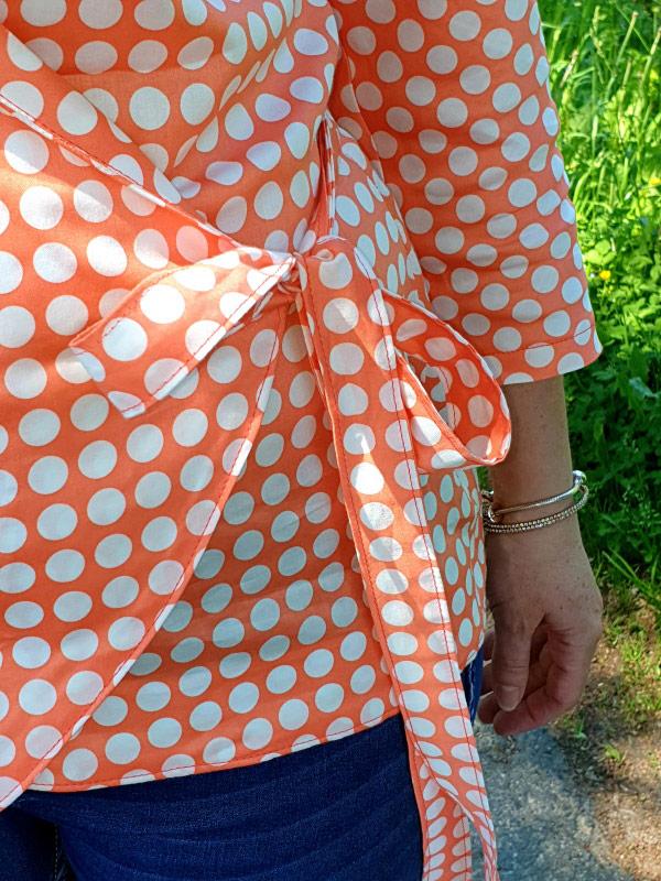 Oceanne 40 Tupfen Orange Detail Schleife